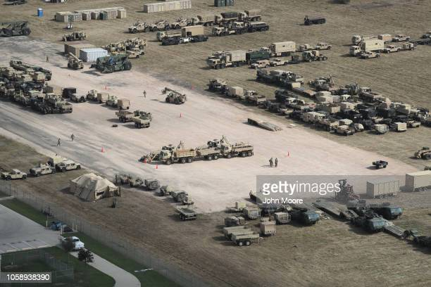 Army vehicles sit parked at a new military camp under construction at the U.S.-Mexico border on November 7, 2018 in Donna, Texas. The forward...