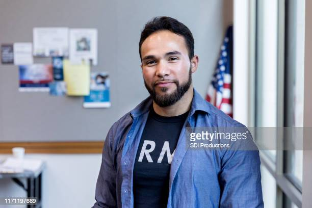 Army vet poses for portrait in front of American flag