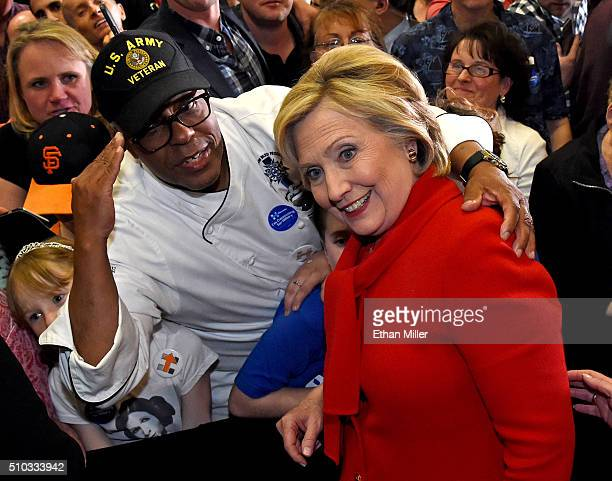 S Army veteran Basil Kimbrew poses with Democratic presidential candidate Hillary Clinton after she spoke at a getoutthecaucus event at the Mountain...