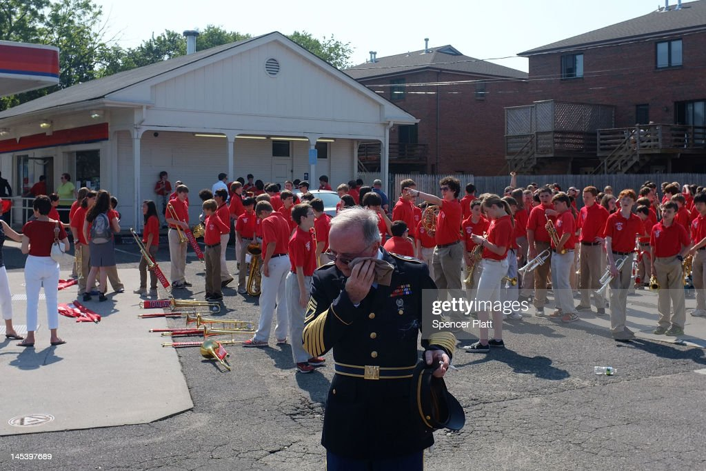 U.S. Army veteran Elliot Daniel's tries to stay cool before the start of the annual Memorial Day Parade on May 28, 2012 in Fairfield, Connecticut. Across America towns and cities will be celebrating veterans of the United States Armed Forces and the sacrifices they have made. Memorial Day is a federal holiday in America and has been celebrated since the end of the Civil War.