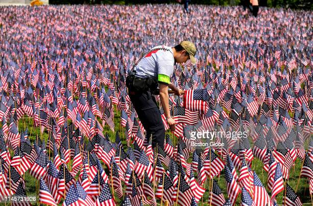 Army veteran Gary Yeung from Boston plants some flags as one of the hundreds of volunteers planting 37,297 American flags at the Boston Common on May...