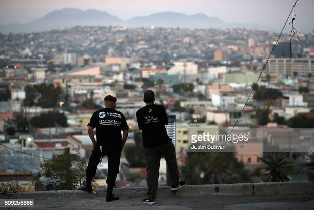 S Army veteran Hector Barajas and deported US Marine Corp veteran Alex Gomez take in a view of the city on July 3 2017 in Tijuana Mexico The Deported...