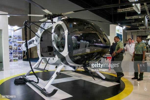 Army visitors looking at the MD helicopter from Sapura Aero Company at DSA The 16th Defense Service Asia Exhibition and Conference also known as DSA...