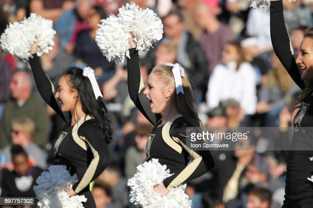 Army West Point cheerleaders perform during the Armed Forces Bowl game between San Diego State and Army on December 23 at Amon G Carter Stadium in...