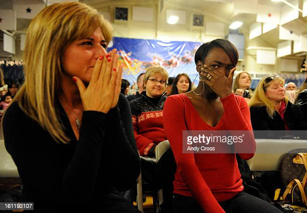 Army wives Sherry Schultz left and Alexa Thornton right shed tears of joy awaiting their husbands William Schultz and Jerrel Thornton both with the...
