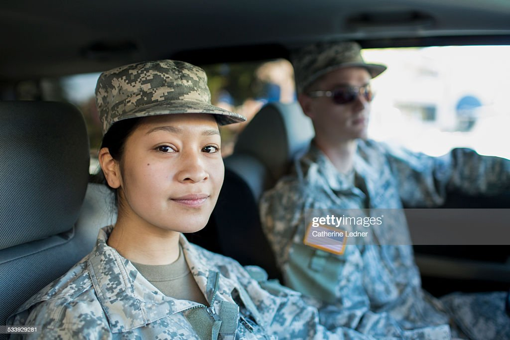 Army Woman and Man in Car : Stock Photo