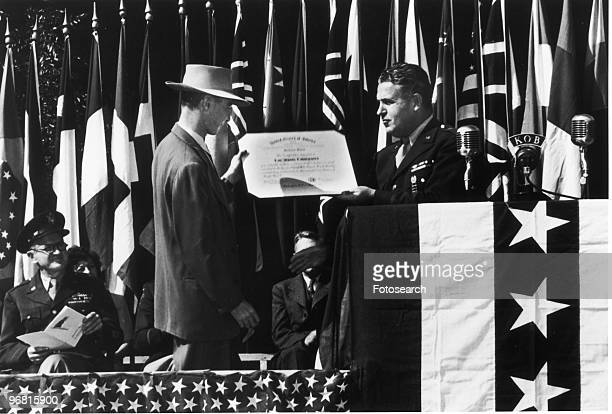ArmyNavy Award of excellence presented by General L R Groves to Director Robert Oppenheimer circa 1940s