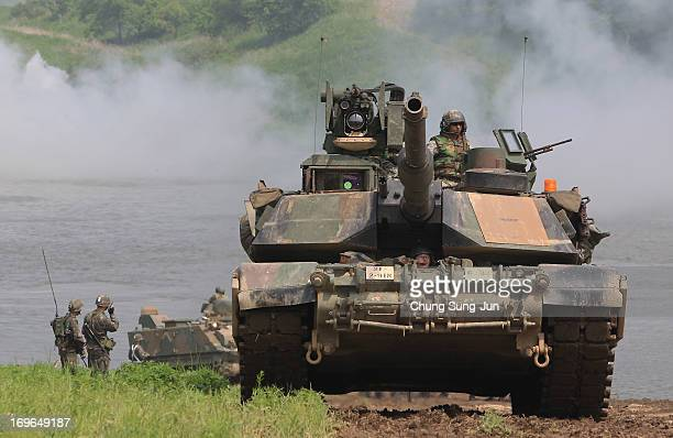 S Army's M1A2 tank and soldiers from 2nd Battalion 9th Infantry Regiment of the 1st Armored Brigade Combat Team of 2nd infantry division participate...