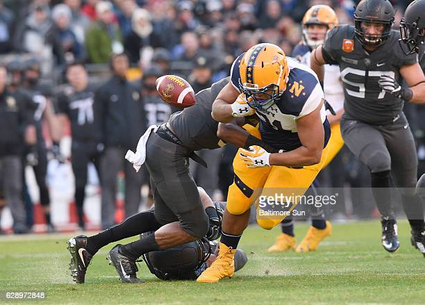 Army's Xavier Moss left hits Navy fullback Shawn White forcing a fumble in the first quarter at MT Bank Stadium in Baltimore on Saturday Dec 10 2016...