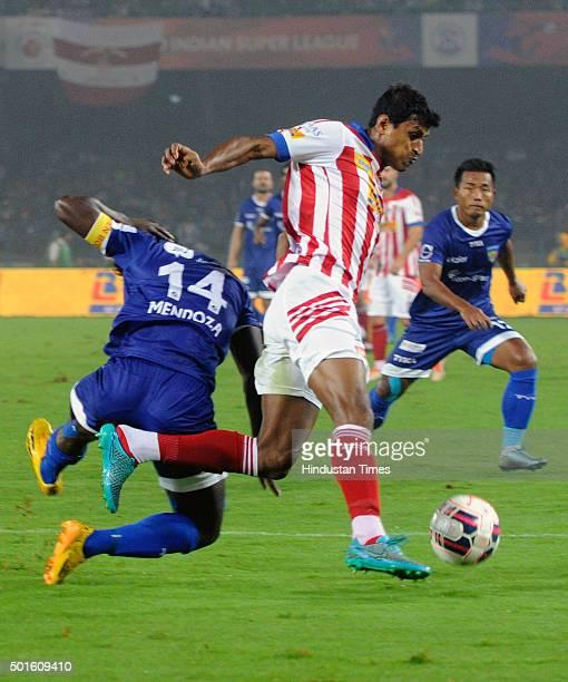 Arnab Mondal of Atletico de Kolkata vying for the ball with Chennaiyin FC players during their ISL semifinal second leg match at Yuva Bharati...