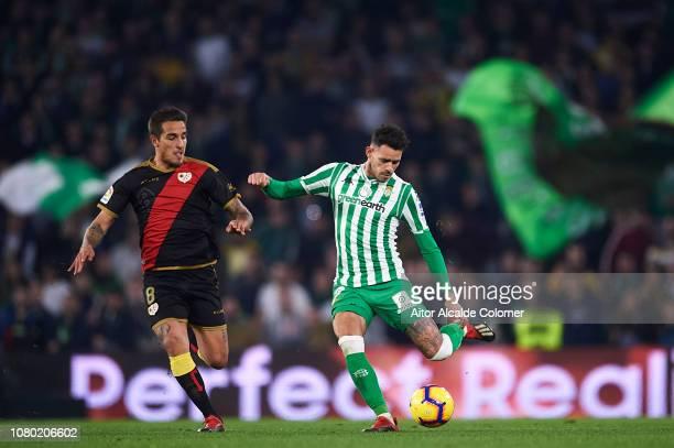 Arnaldo Antonio Sanabria of Real Betis Balompie being followed by Oscar Guido Trejo of Rayo Vallecano during the La Liga match between Real Betis...