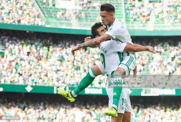 Arnaldo Antonio Sanabria of Real Betis Balompie ceebrates after scoring the first goal for Real Betis Balompie with Antonio Barragan of Real Betis...