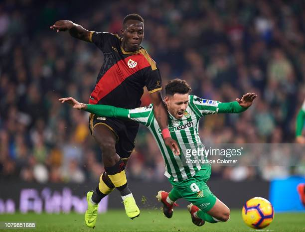 Arnaldo Antonio Sanabria of Real Betis Balompie competes for the ball with Luis Advincula of Rayo Vallecano during the La Liga match between Real...