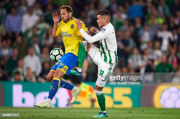 Arnaldo Antonio Sanabria of Real Betis Balompie competes for the ball with Dani Castellano of Union Deportiva Las Palmas during the La Liga match...
