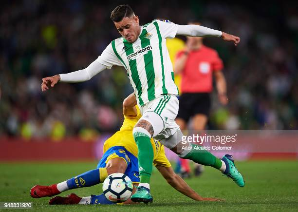 Arnaldo Antonio Sanabria of Real Betis Balompie competes for the ball with Alejandro Galvez of Union Deportiva Las Palmas during the La Liga match...