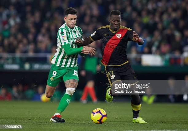 Arnaldo Antonio Sanabria of Real Betis competes for the ball with Advincula of Rayo Vallecano during the La Liga match between Real Betis Balompie...