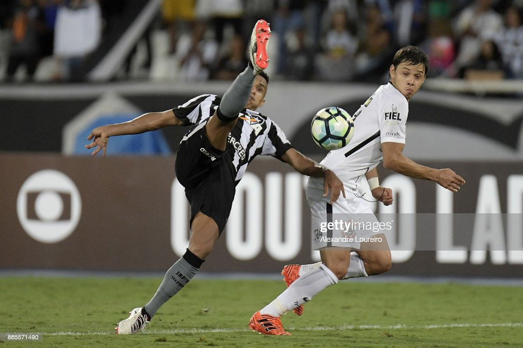 Arnaldo (L) of Botafogo battles for the ball with Angel Romero of Corinthians during the match between Botafogo and Corinthians as part of Brasileirao Series A 2017 at Engenhao Stadium on October 23, 2017 in Rio de Janeiro, Brazil.
