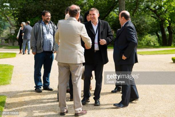 Arnaldo Otegi Leader of the political party EH Bildu shakes hands with Brian Currin member of the International Contact Group as he arrives at the...