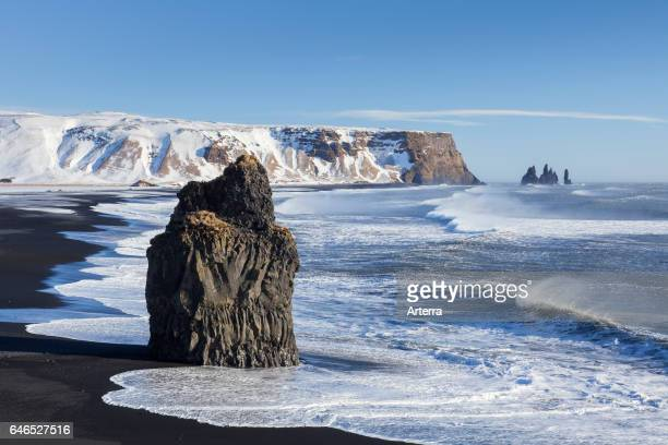 Arnardrangur / Eagle rock basalt sea stack on the Black sand beach Reynisfjara near Vik i Myrdal Iceland