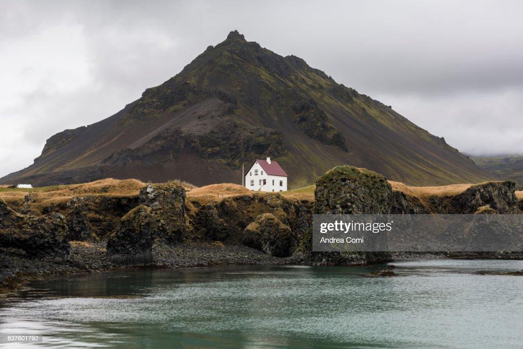 Arnarstapi, Snaefellsnes Peninsula, Western Iceland, Iceland. Lonely house on the coast : Stock Photo