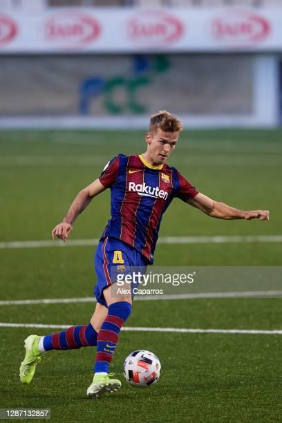 Arnau Comas of FC Barcelona B runs with the ball during the Segunda Division B Group IIIA match between CE L'Hospitalet and FC Barcelona B at Estadi...