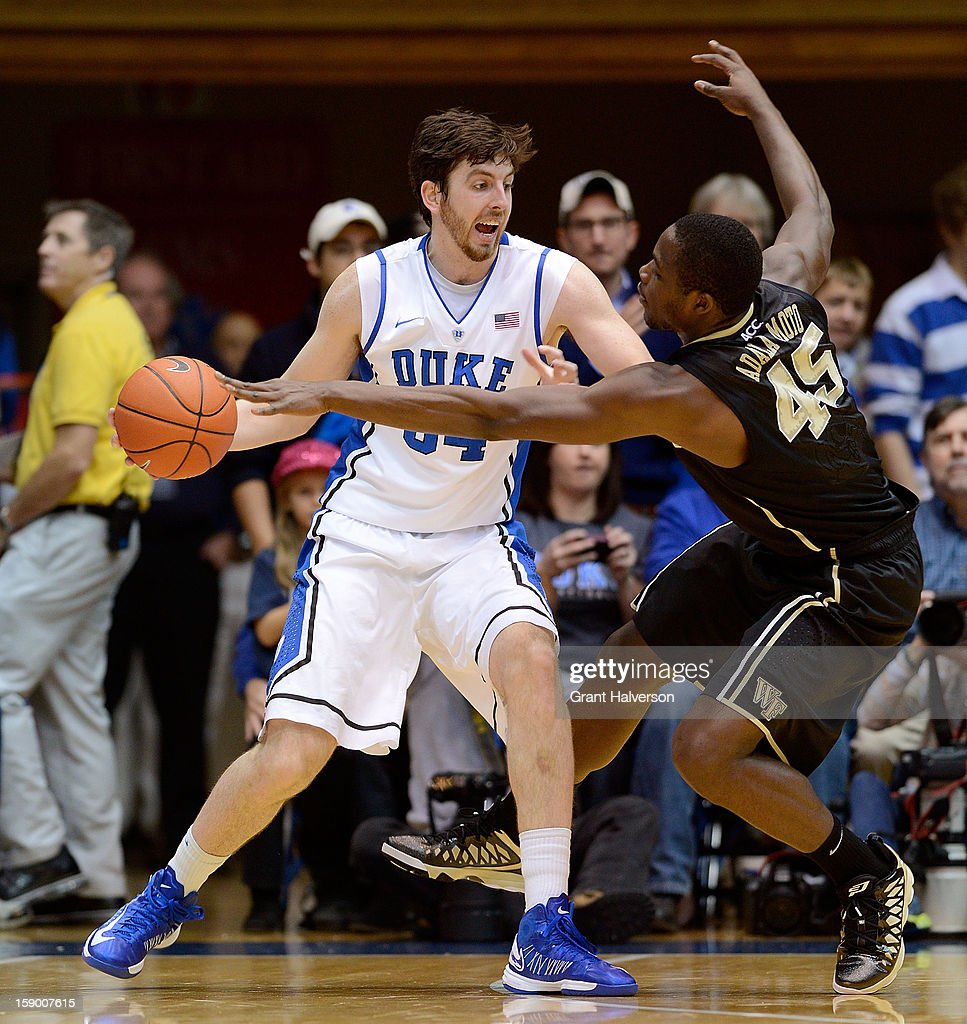 Arnaud Adala Moto #45 of the Wake Forest Demon Deacons defends Ryan Kelly #34 of the Duke BlueDevils during play at Cameron Indoor Stadium on January 5, 2013 in Durham, North Carolina.
