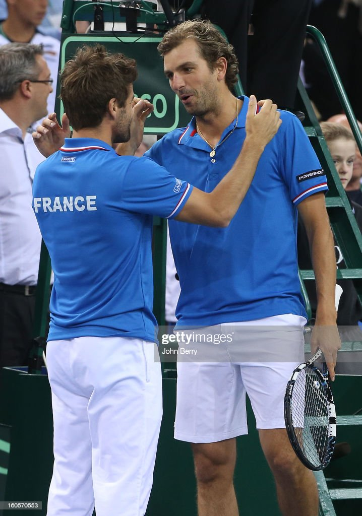 Arnaud Clement, coach of France congratulates Julien Bennetteau for his victory with teammate Michael Llodra after the doubles match against Jonathan Erlich and Dudi Sela of Israel on day two of the Davis Cup first round match between France and Israel at the Kindarena stadium on February 2, 2013 in Rouen, France.