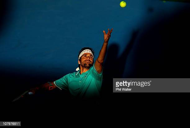 Arnaud Clement of France serves during his match against Xavier Malisse of Belguim on day two of the Heineken Open at the ASB Tennis Centre on...