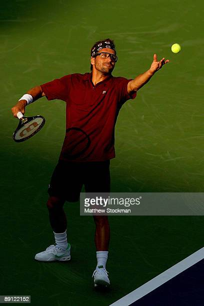 Arnaud Clement of France serves to Sam Querrey during the Indianapolis Tennis Championships on July 20 2009 at the Indianapolis Tennis Center in...