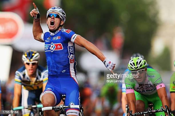 Arnaud Demare of France and FDJ crosses the finish line to win the London Surrey Classic from the Queen Elizabeth Olympic Park to The Mall on August...