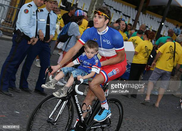 Arnaud Demare of France and FDJfr and his son during the lap of honor after the twenty one and last stage of the 2014 Tour de France a 134 km...