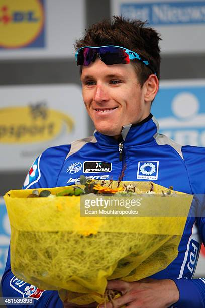 Arnaud Demare of France poses on the podium after his second place in the GentWevelgem Cycle Race on March 30 2014 in Gent Belgium