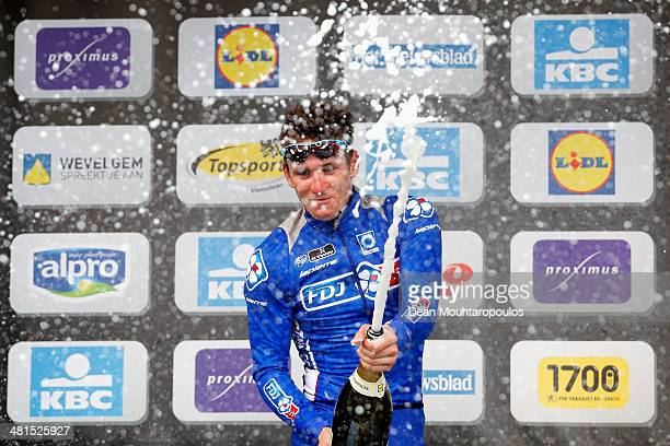 Arnaud Demare of France sprays champange on the podium after his second place in the GentWevelgem Cycle Race on March 30 2014 in Gent Belgium
