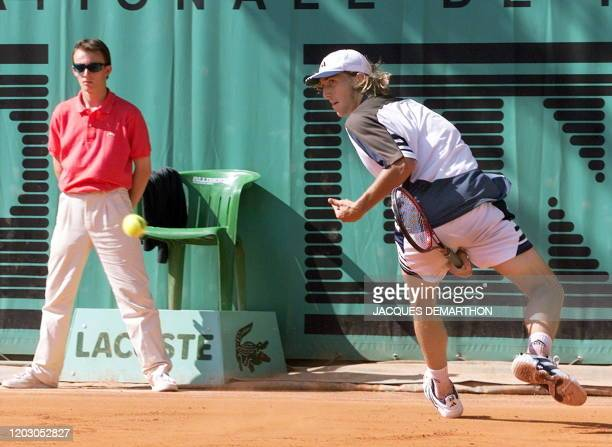 Arnaud Di Pasquale of France hits the ball from between his legs to Christophe Rochus of Belgium during their first-round match at the French Open in...