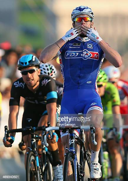 Arnaud Démare of France and FDJfr celebrates winning stage six of the Tour of Qatar from Sealine Beach Resort to Doha Corniche on February 14 2014 in...
