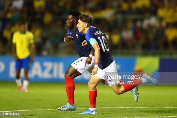 Arnaud KalimuendoMuinga of France celebrates scoring the first goal with Adil Aouchiche during the FIFA U17 World Cup Brazil 2019 semifinal match...