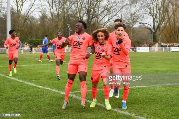 Arnaud KALIMUENDOMUINGA of PSG Xavi SIMONS and Adil AOUCHICHE of PSG celebrate during the Gambardella Cup match between Evry and Paris Saint Germain...