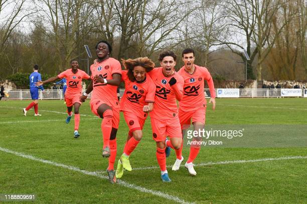 Arnaud KALIMUENDOMUINGA Xavi SIMONS and Adil AOUCHICHE of PSG celebrate during the Gambardella Cup match between Evry and Paris Saint Germain on...