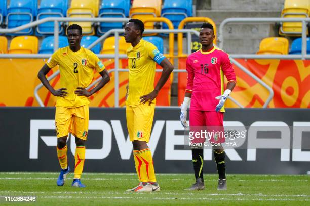 Arnaud Konan, Clement Kanoute and Youssouf Koita of Mali look dejecetd during the 2019 FIFA U-20 World Cup group E match between Mali and France at...