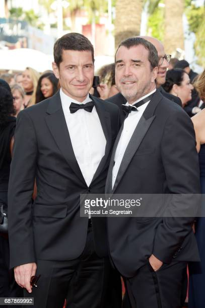 Arnaud Lagardere and a guest attend the The Beguiled screening during the 70th annual Cannes Film Festival at Palais des Festivals on May 24 2017 in...
