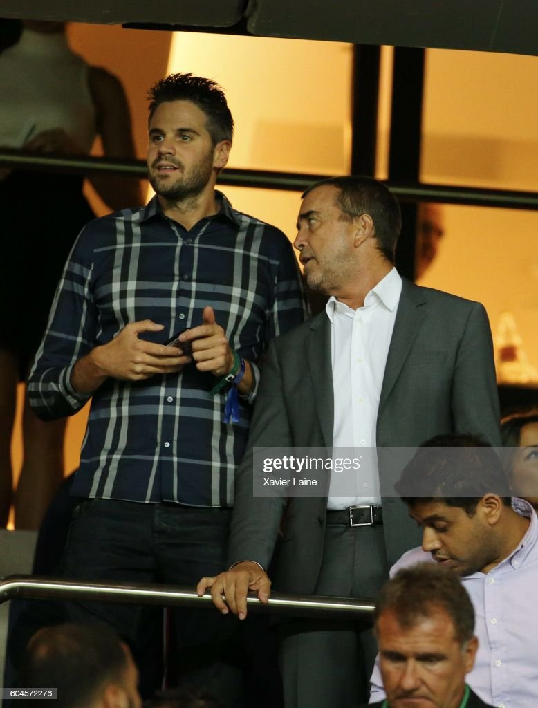 Arnaud Lagardere and his son attend the UEFA Champions League group A between Paris Saint-Germain and Arsenal FC at Parc Des Princes on september 13, 2016 in Paris, France.