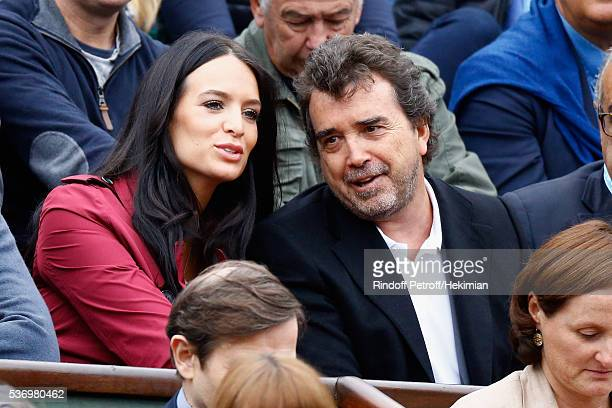Arnaud Lagardere and his wife Jade are watching the match between Richard Gasquet and Andy Murray during the French Tennis Open at Roland Garros on...