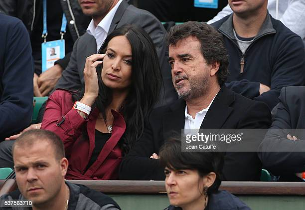 Arnaud Lagardere and his wife Jade Lagardere cheer for their friend Richard Gasquet of France against Andy Murray of Great Britain during day 11 of...