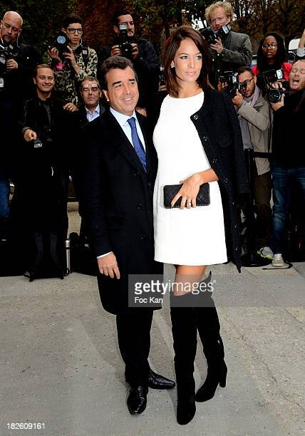 Arnaud Lagardere and Jade Foret attend the Chanel show as part of the Paris Fashion Week Womenswear Spring/Summer 2014 at the Grand Palais on October...