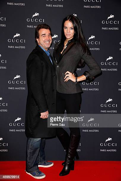 Arnaud Lagardere and Jade Foret attend the Gucci Paris Masters 2014 on December 4, 2014 in Villepinte, France.