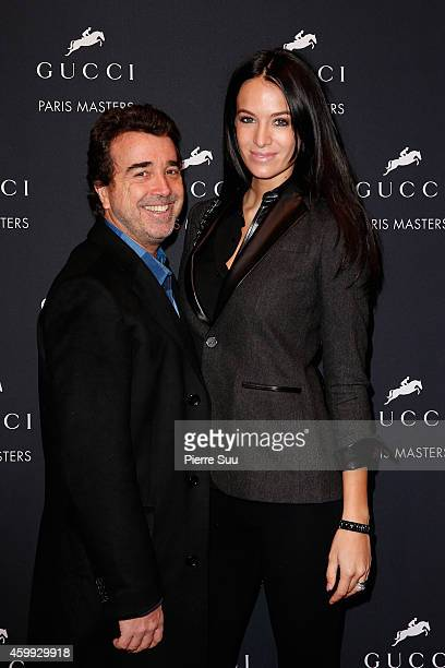 Arnaud Lagardere and Jade Foret attend the Gucci Paris Masters 2014 on December 4 2014 in Villepinte France