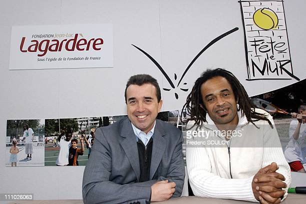 Arnaud Lagardere and Yannick Noah at press conference 'Fete le Mur' in Grigny in Paris France on April 05th 2006