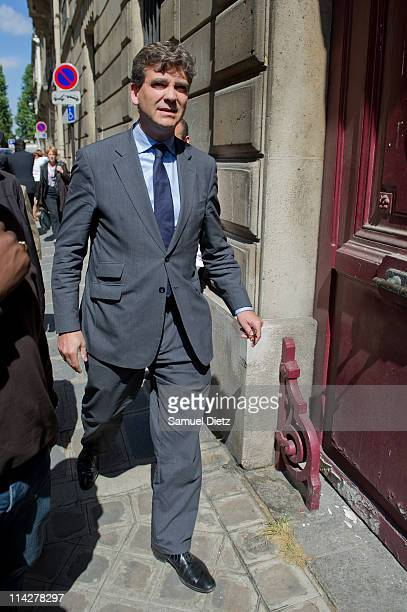Arnaud Montebourg arrives at the French Socialist Party headquarters before a meeting of the National Executive on May 17 2011 in Paris France A...