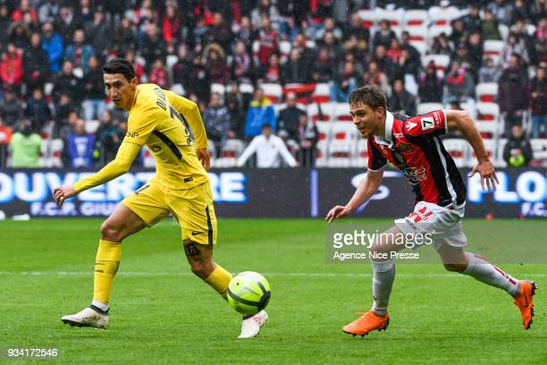 Arnaud Souquet of Nice and Angel Di Maria of PSG during the Ligue 1 match between OGC Nice and Paris Saint Germain at Allianz Riviera on March 18...