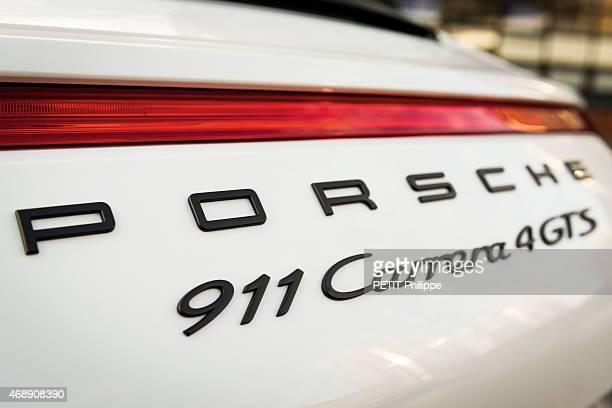 Arnaud Tsamere tests the model Porsche 911 Carrera 4 GTS cabriolet in BoulogneBillancourt France on February 02 2015
